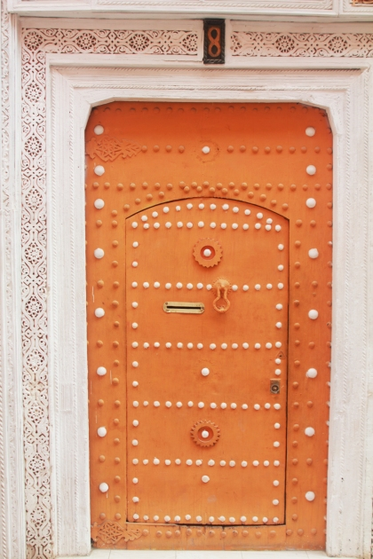 An intricately crafted riad door in the old city.