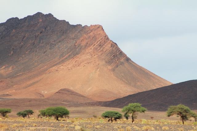 Dramatic Mordor-esque landscapes protrude along the horizon.